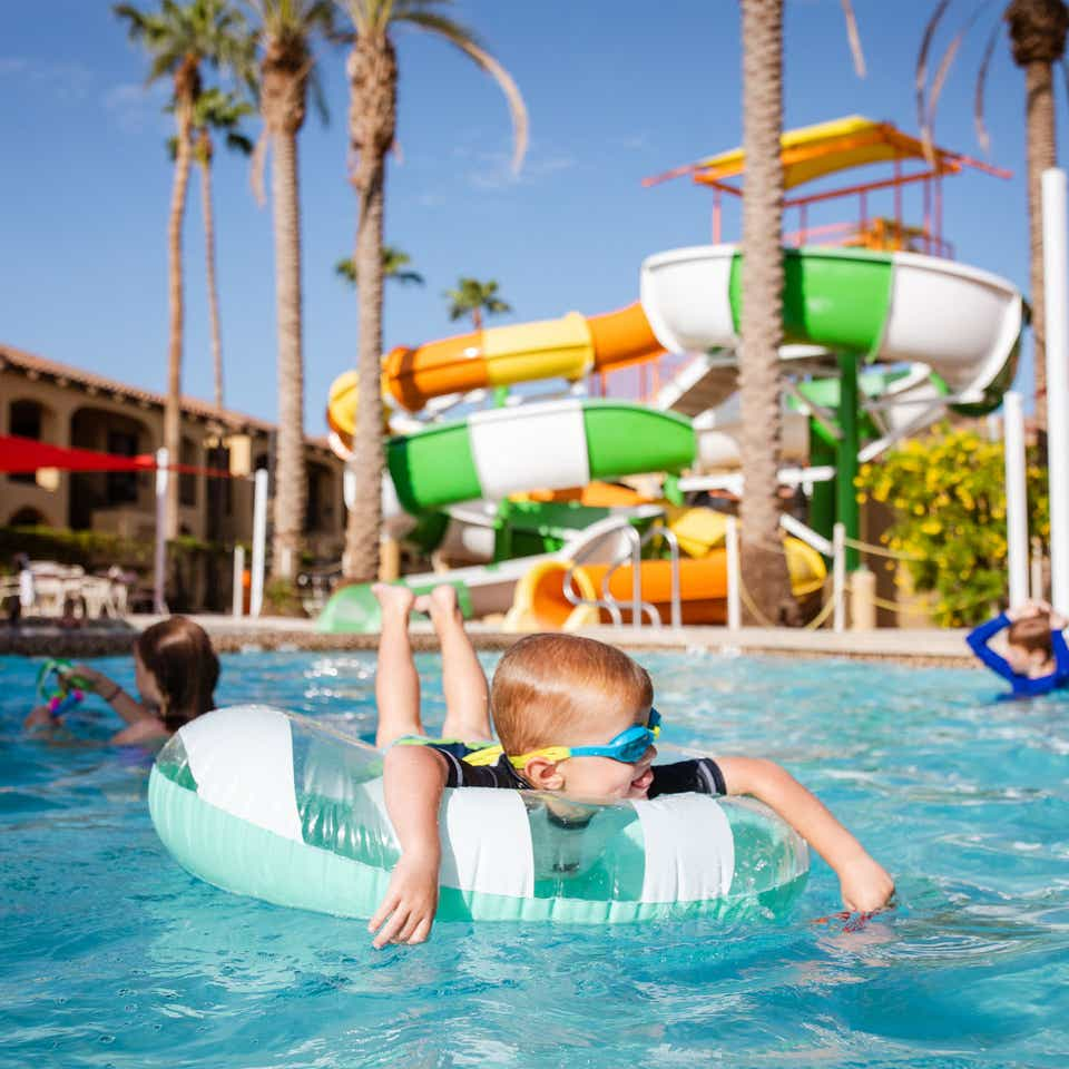 Young child floating in pool at Scottsdale Resort.