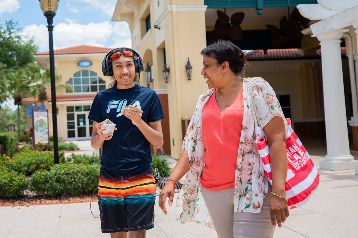 Special Olympic Athlete, Roan Luallen (left), and his mother, Sherryll Luallen (right), enjoy a cool treat outside of our Orange Lake Resort located in Orlando, Florida.
