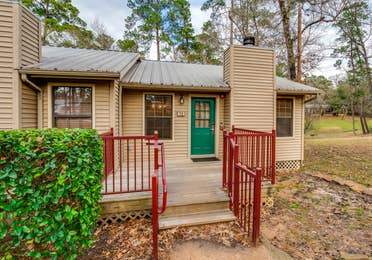 Exterior of cabin in a two bedroom cabin at Piney Shores Resort in Conroe, Texas