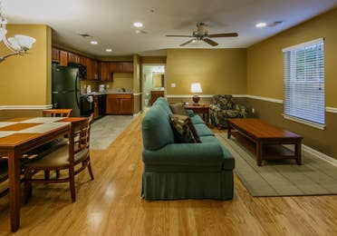 Living room with dining area in a one-bedroom ambassador villa at the Hill Country Resort in Canyon Lake, Texas.