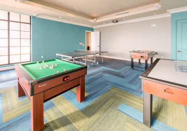 Game room with air hockey, Foosball, and ping pong tables at Sunset Cove Resort