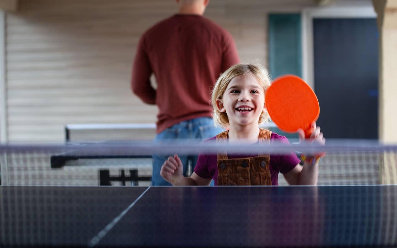 Child playing ping pong at David Walley's Resort in Genoa, Nevada.