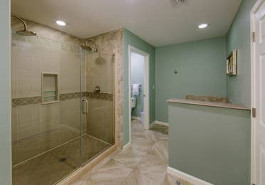 Bathroom with walk-in shower in a villa at Orlando Breeze Resort.