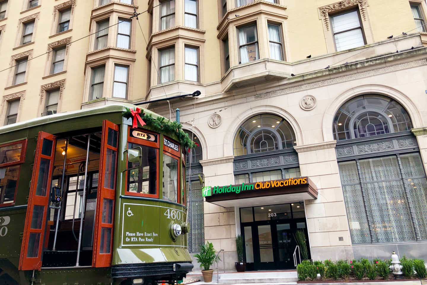 A green trolley decorated for the holidays stops in front of our resort in New Orleans, Louisiana.