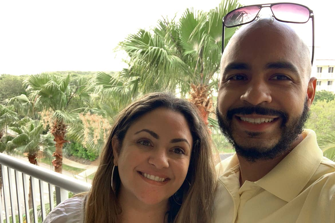 Val (left) and her husband, Gio (right) stand on the balcony of our Cape Canaveral Beach Resort villa.