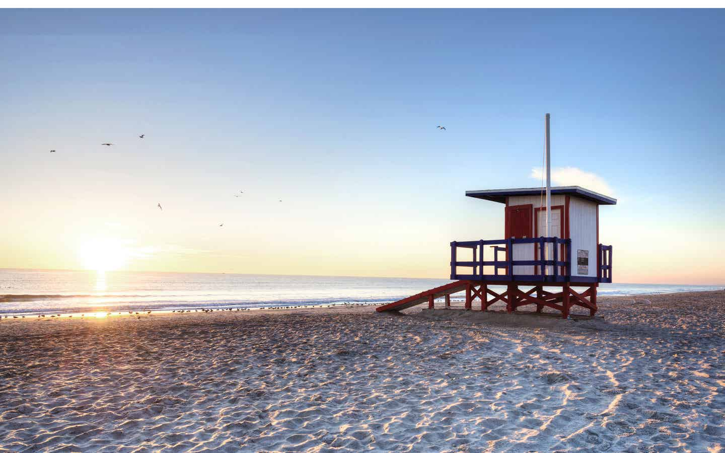 Cape Canaveral Beach with Lifeguard hut at sunset.