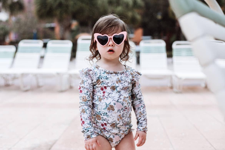 Mia's daughter in heart sunglasses