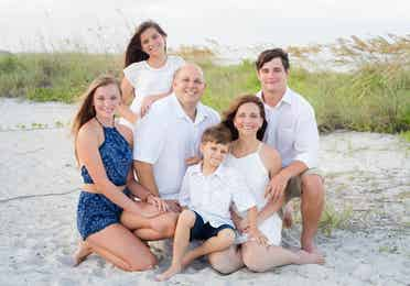 Family getting beach photography done at Cocoa Beach, Florida near Cape Canaveral Beach Resort.