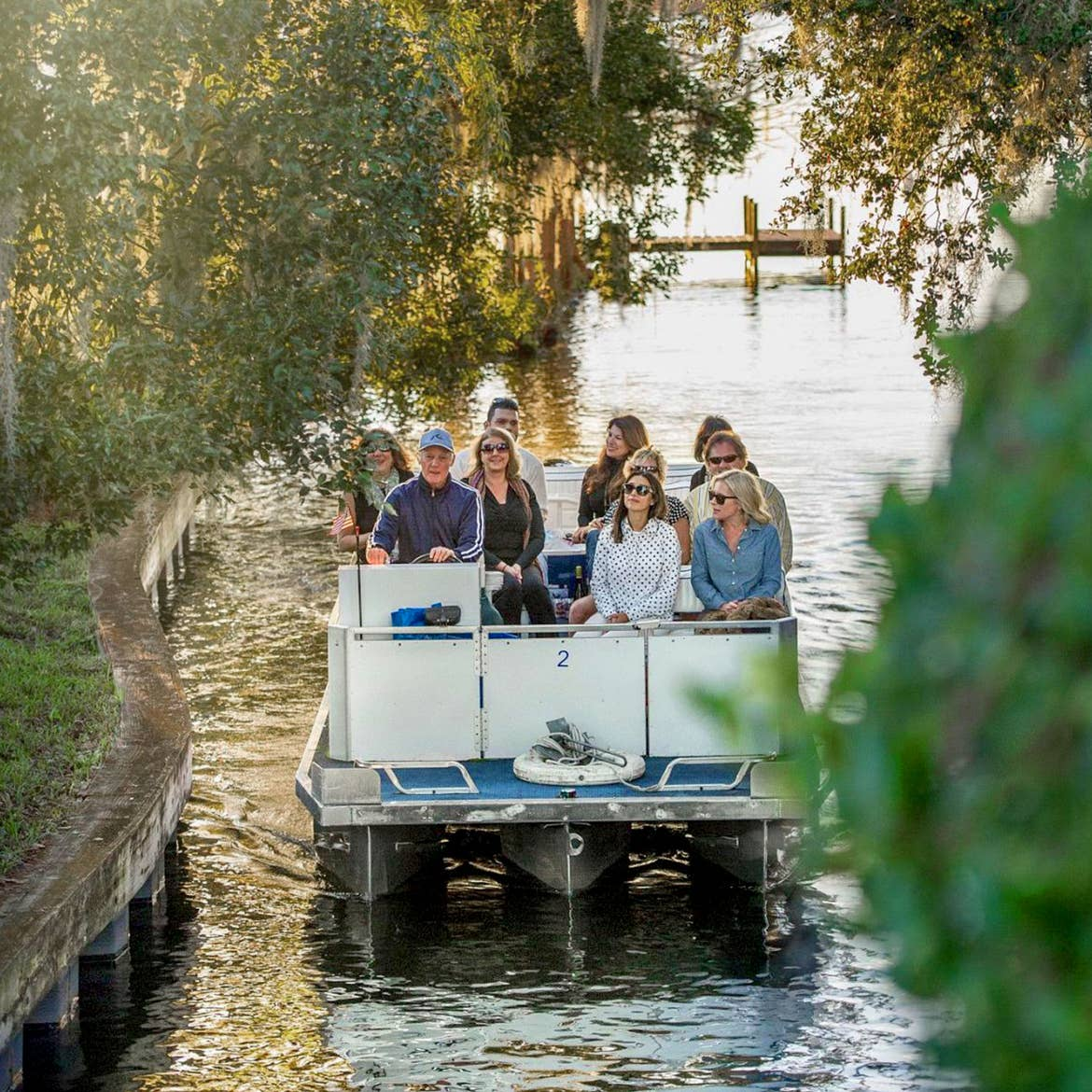 A tour guide speaks with the guests on board as they float through a canal. Photo courtesy of Visit Orlando