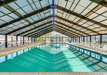 Indoor swimming pool and beach chairs at Piney Shores Resort in Conroe, Texas