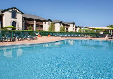 Outdoor pool with sun chairs at Lake Geneva Resort in Wisconsin.