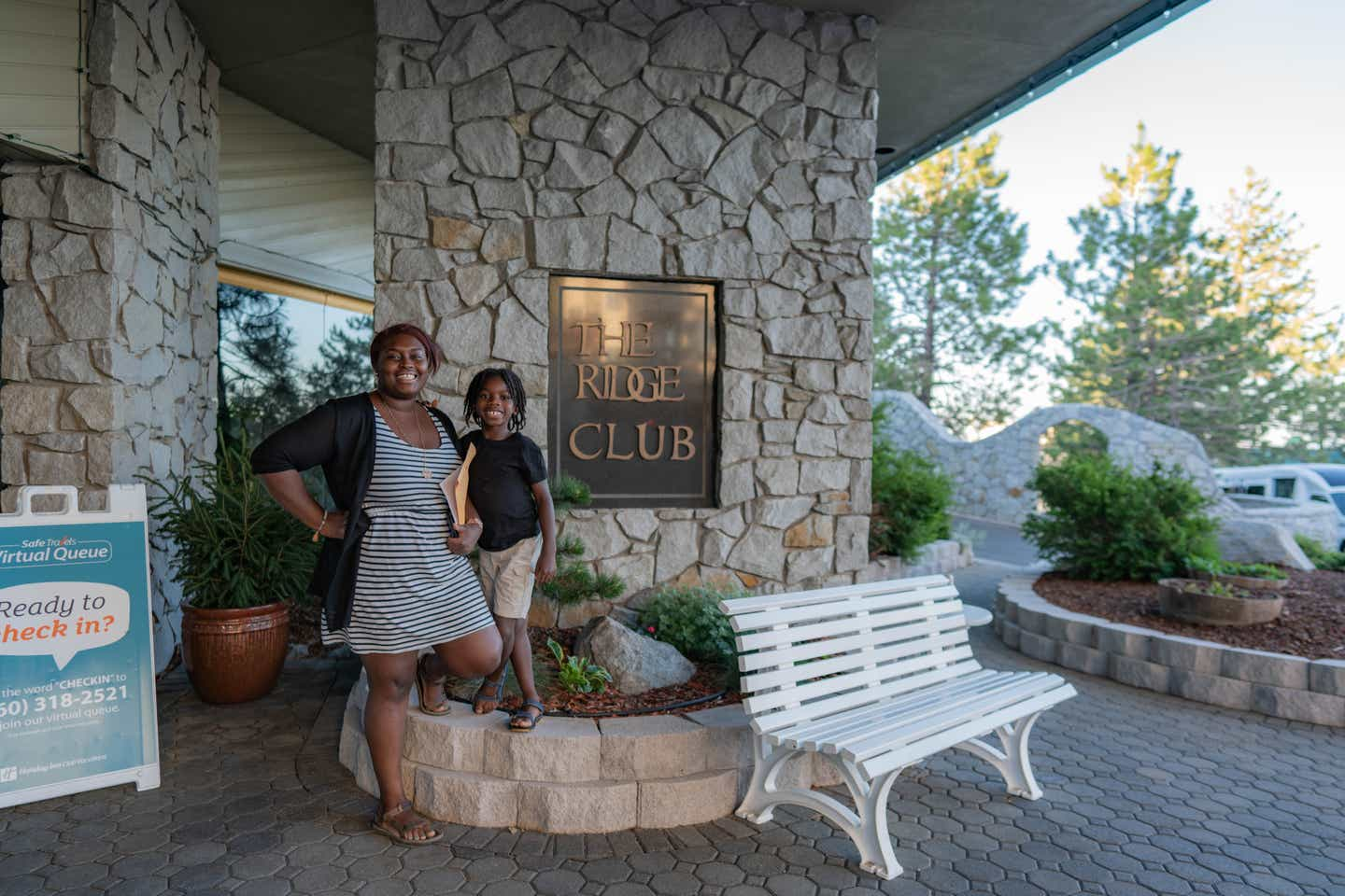 Karen and Aiden by the sign at Tahoe Ridge Resort