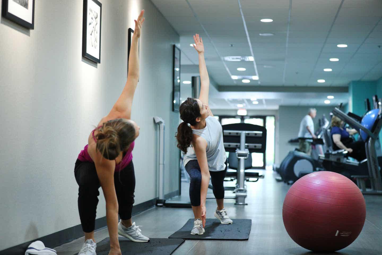 Raff Esquivel and her wife practicing yoga at Orange Lake Resort