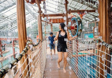 Two guests walking through waterpark at Villages Resort in Flint, Texas.