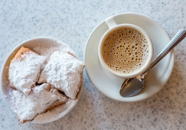 A cup of coffee and three beignets in New Orleans.