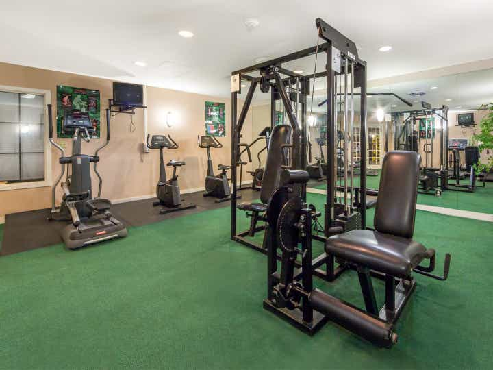 Fitness center with elliptical machines, stationary bicycles and weights at Timber Creek Resort in De Soto, Missouri.
