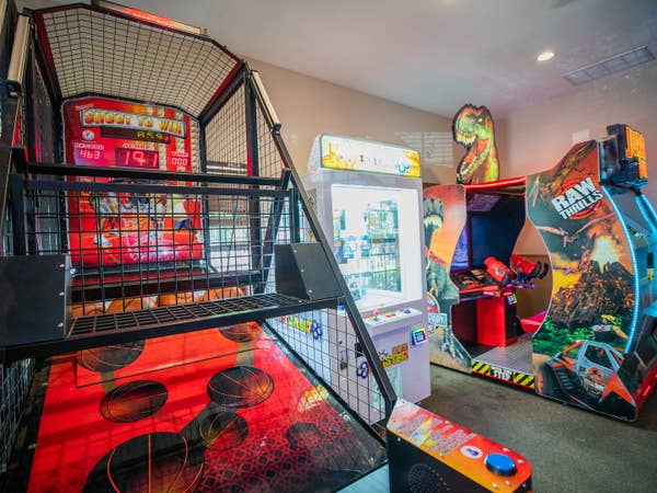 Arcade with Pop-a-Shot, Jurassic Park Raw Thrills and Key Faster games at Villages Resort in Flint, Texas