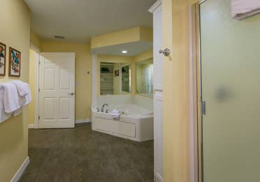 Bathroom with large bathtub and walk-in shower in a one-bedroom Presidential villa at Hill Country Resort in Canyon Lake, Texas