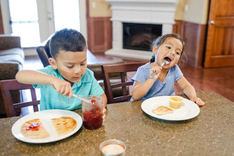 Angelica Kajiwara's kids enjoying snack time at our Holiday Hills Branson Resort at the kitchen countertop.
