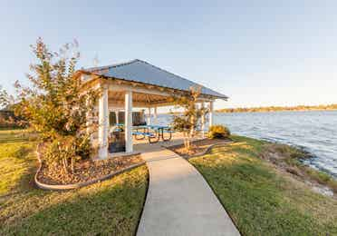 Outdoor covered picnic tables at Piney Shores Resort in Conroe, Texas