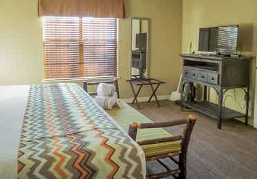 Bedroom with TV in a two-bedroom villa at the Holiday Hills Resort in Branson Missouri.
