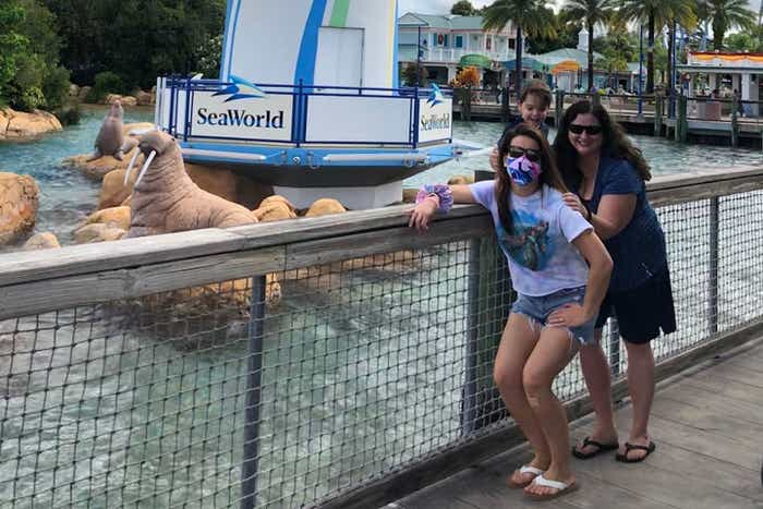 Jennifer Harmon, Theresa and son are posed in front of the SeaWorld Orlando Lighthouse.
