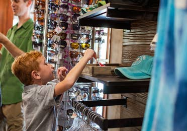 Small child browsing through Marketplace at Hill Country Resort in Canyon Lake, Texas.