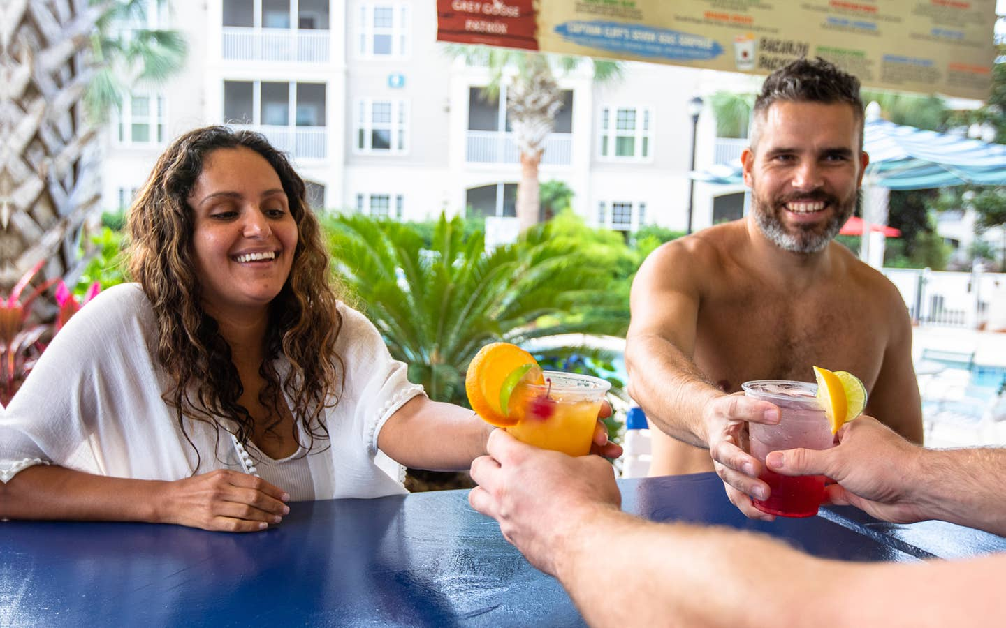 Two adults getting drinks at outdoor pool bar at South Beach Resort in Myrtle Beach, South Carolina.