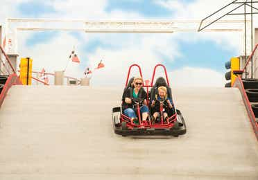 Family on go-karts at a theme park in Branson Missouri.