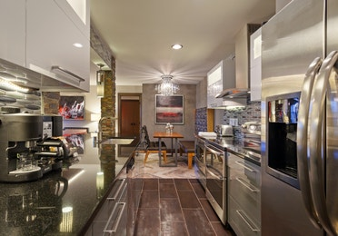 Kitchen and dining area in a one-bedroom Signature Villa at Desert Club Resort in Las Vegas