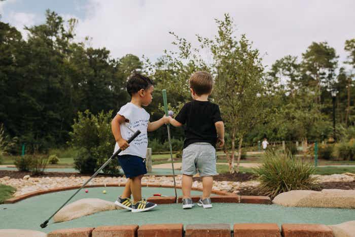 Kids playing putt putt