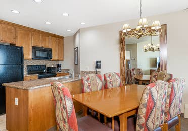 Dining area and kitchen in a Ridge Tahoe two-bedroom villa at Tahoe Ridge Resort