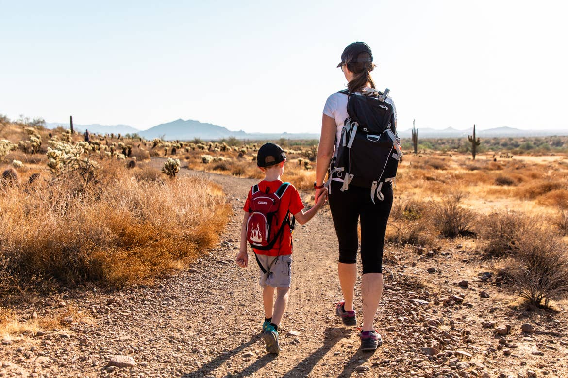 Author Jessica Averett (right) holds her sons hand (left) as they walk through the McDowell Sonoran Preserve.
