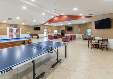 Activity center with pool table, ping pong table and flat screen TVs at Orlando Breeze Resort in Florida.