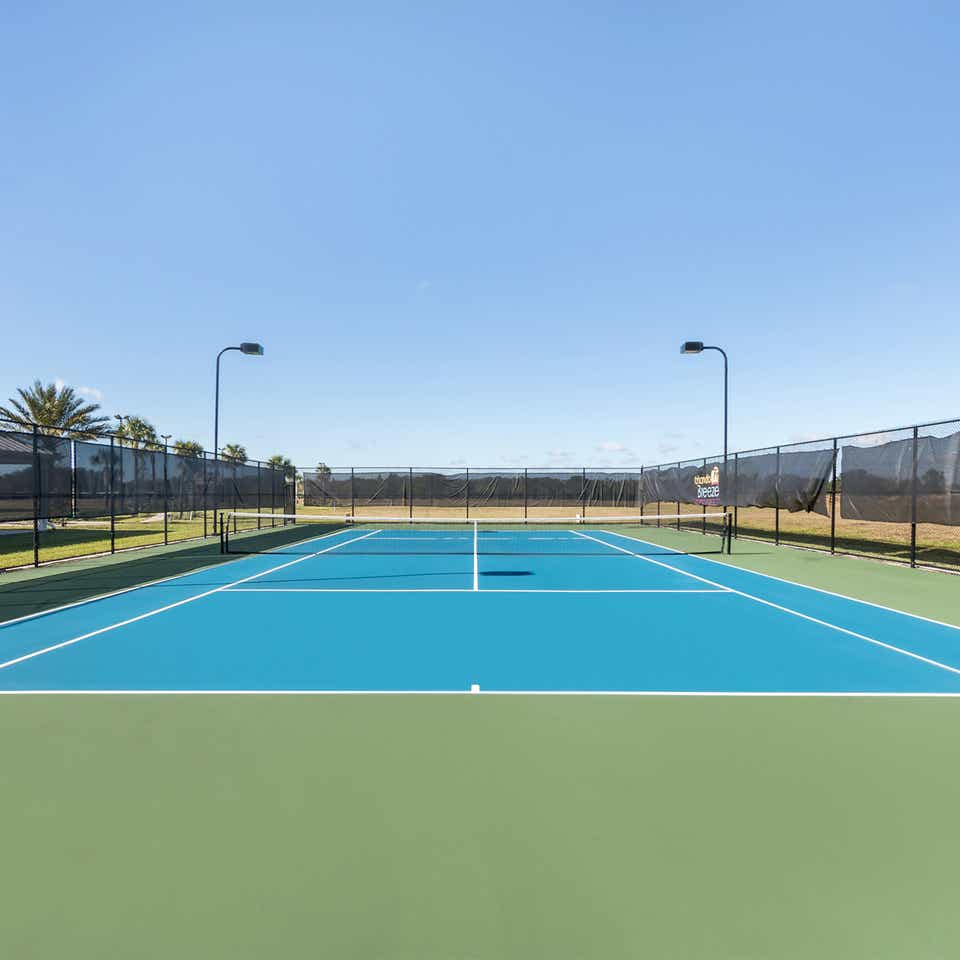 Outdoor tennis court at Orlando Breeze Resort near Orlando, Florida.