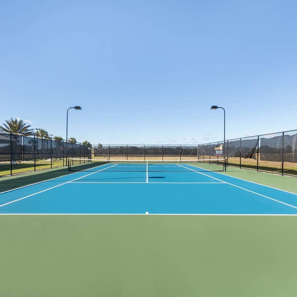 Outdoor tennis court at Orlando Breeze Resort near Orlando, Florida.