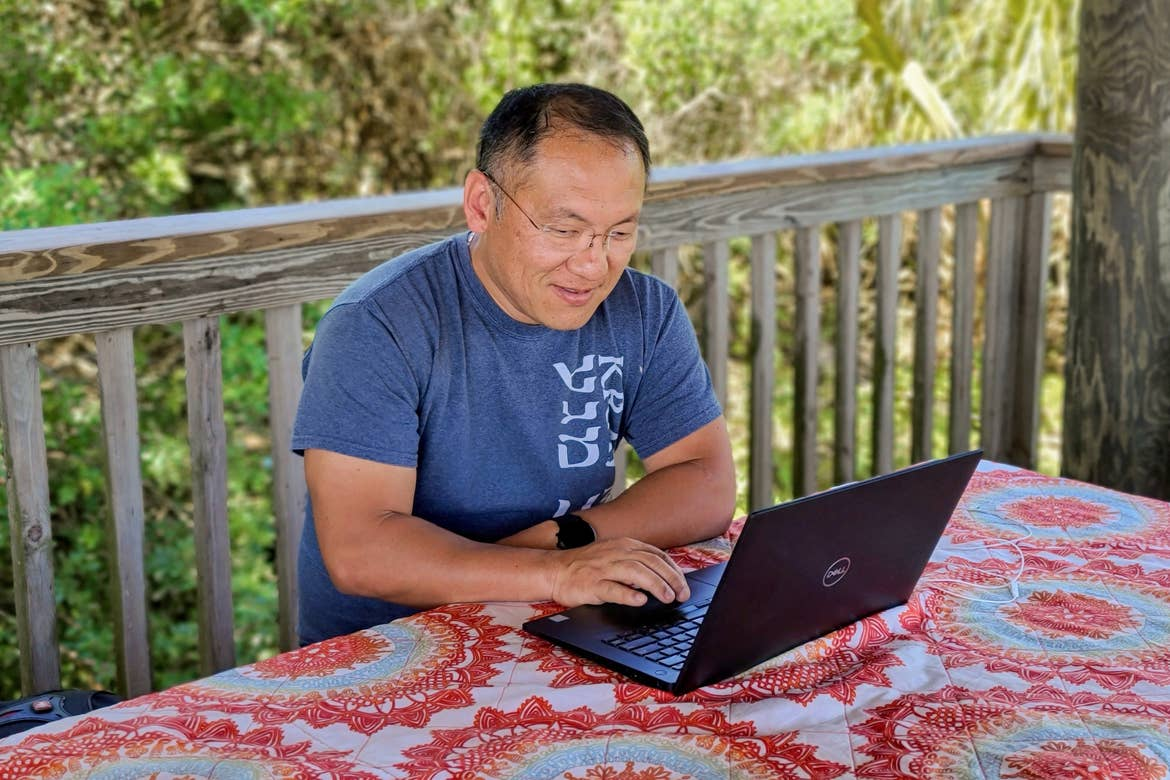 Featured Contributor, Angelica Kajiwara's husband works on a deck remotely.