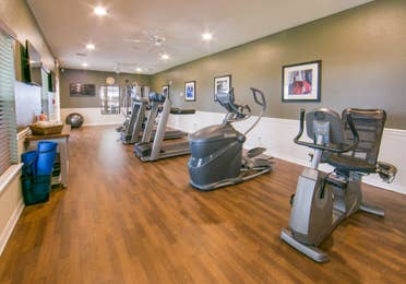 Fitness center with treadmills and ellipticals at Orlando Breeze Resort in Florida.