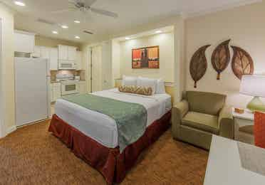 Bedroom with a kitchenette in a two-bedroom presidential villa at Villages Resort