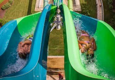 Kids sliding down waterslide at Water Country USA near Williamsburg Resort.