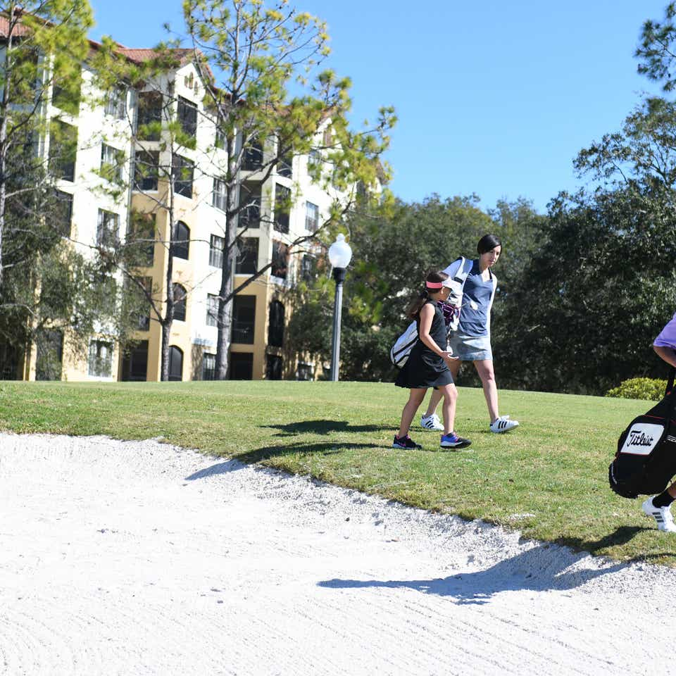 Golfers walking on course in East Village at Orange Lake Resort near Orlando, Florida