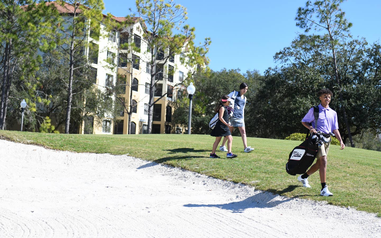 Golfers walking on course in East Village at Orange Lake Resort near Orlando, Florida