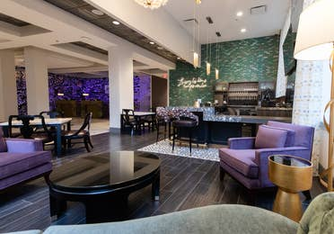 Maritime Bar & Lounge and seating area with purple chairs near the front near at New Orleans Resort in Louisiana.