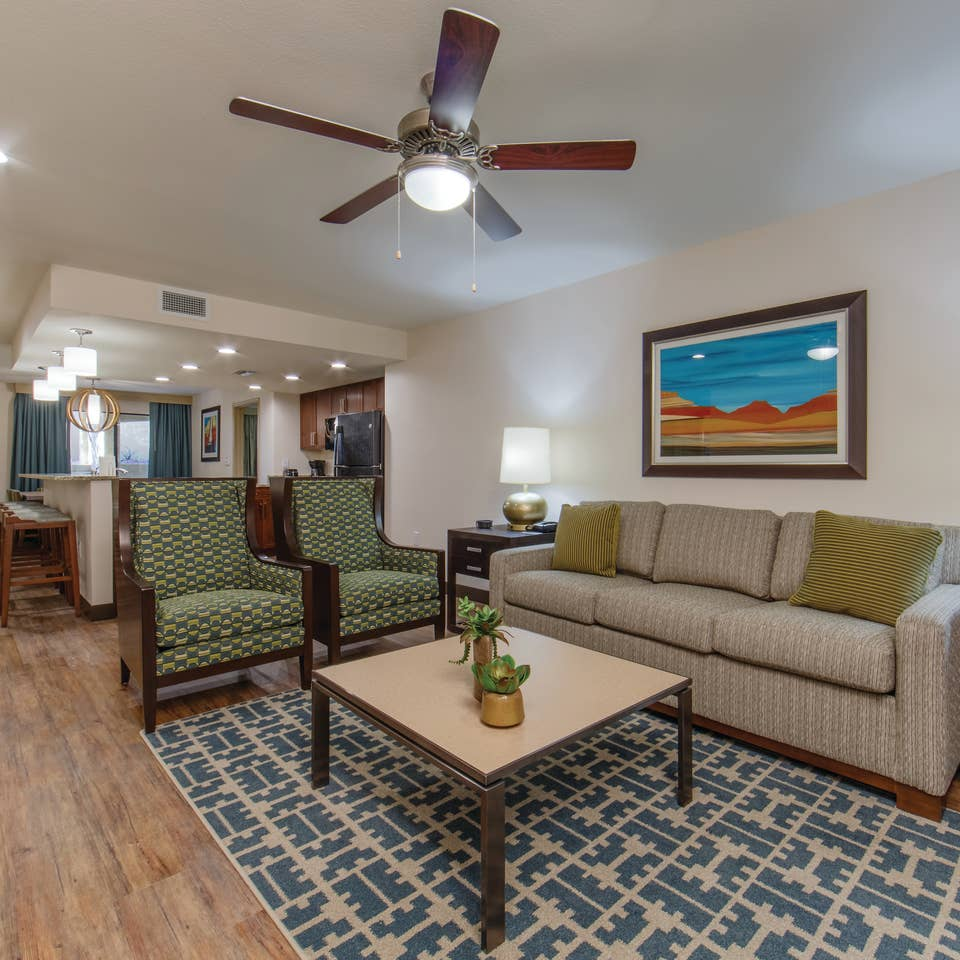 Living room with couch and two accent chairs in a three-bedroom villa at Scottsdale Resort