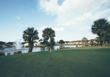 Golf course with lake fountain in the background in West Village at Orange Lake Resort near Orlando, Florida
