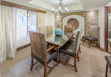 Dining room table with seating for six in a Two-Bedroom Signature Collection Villa at the Scottsdale Resort in Arizona