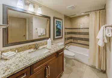 Full bathroom with shower/tub combination, sink with mirror, and toilet in a one-bedroom villa at Scottsdale Resort
