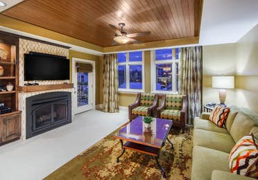 Living room with couch and two chairs at Smoky Mountain Resort in Gatlinburg, Tennessee.