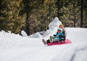 family sledding at the activity center near Lake Geneva Resort, Lake Geneva, WI.