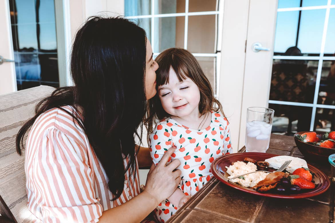 Featured contributor, Mia St. Clair (left), and daughter, Roux (right), enjoy breakfast together on the patio at Orange Lake Resort in Orlando, FL.